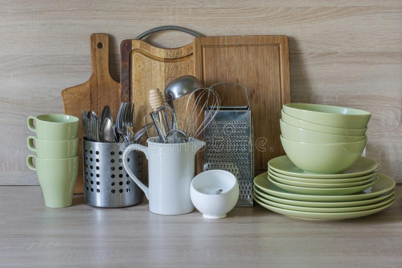 Crockery, tableware, utensils and other different stuff on wooden table-top.Kitchen still life as background for design. Image with copy space stock images