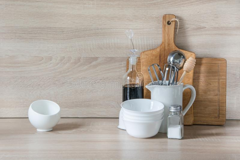 Crockery, tableware, utensils and other different stuff on wooden table-top. Kitchen still life as background for design. Copy spa. Crockery, tableware, utensils stock image