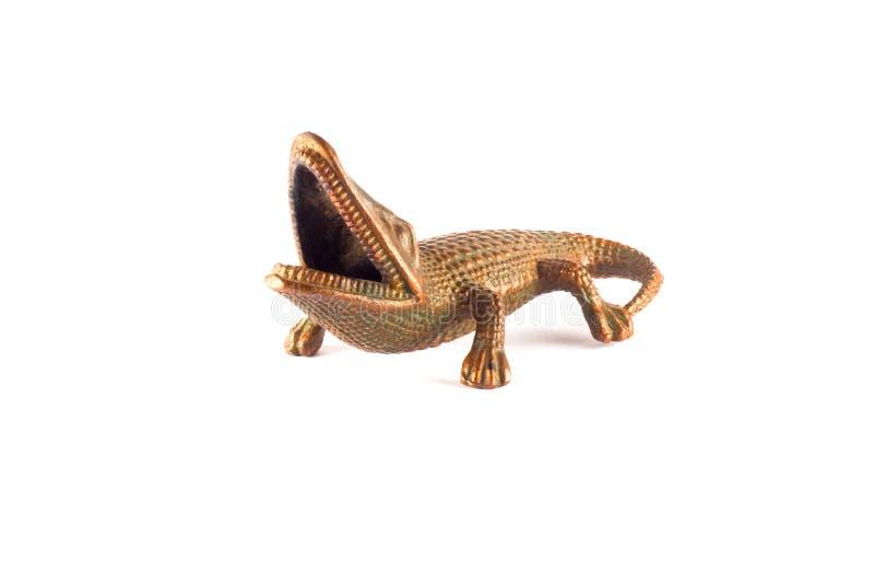 Crocodile. Old made brass figurine stock photography