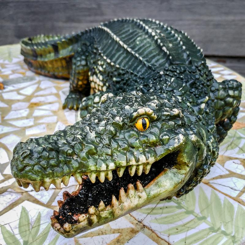 Crocodile Statue on a Mosaic Leaf Table royalty free stock photography