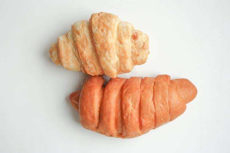 Croissant δύο σε ένα άσπρα φως και ένα σκοτάδι υποβάθρου στοκ εικόνα με δικαίωμα ελεύθερης χρήσης