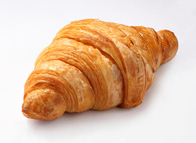 Croissant. A croissant on white background stock photos
