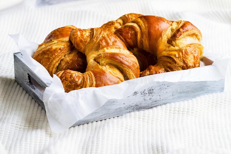 Croissant for breakfast on white woolen surface. Croissant for breakfast on woolen surface stock image