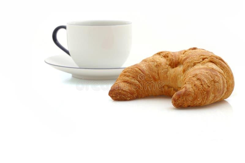Croissant, chávena de café imagens de stock royalty free