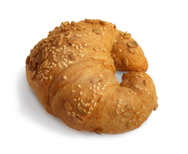 Croissant com sésamo, sementes de abóbora isoladas em um fundo branco fotos de stock