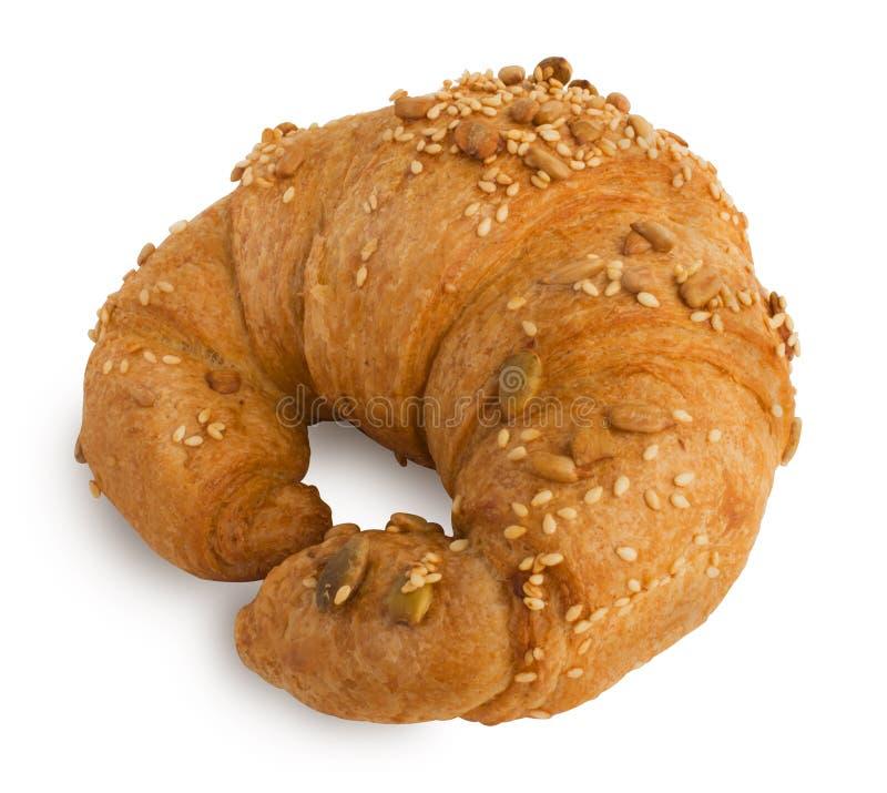 Croissant com sésamo, sementes de abóbora isoladas em um fundo branco foto de stock royalty free