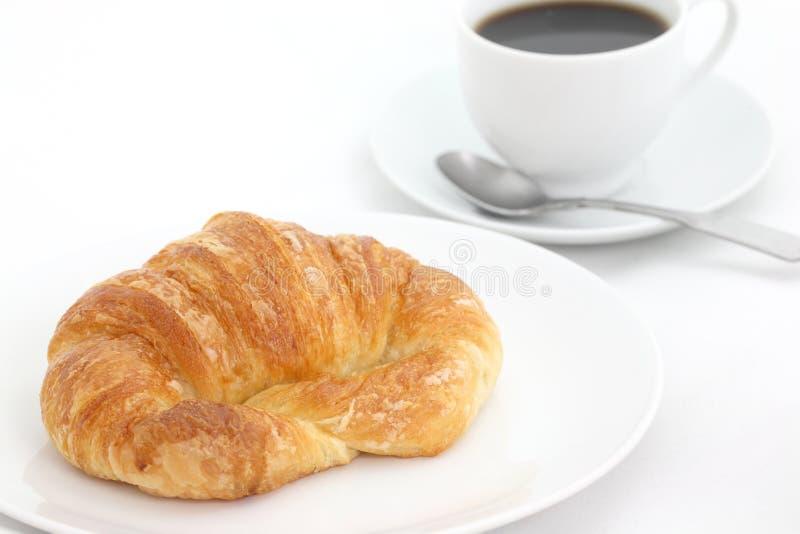 Croissant con caffè fotografie stock libere da diritti