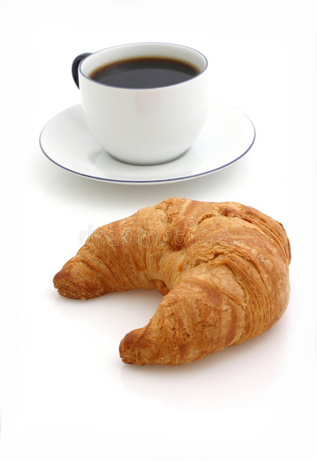 Croissant, cup of coffee royalty free stock photo
