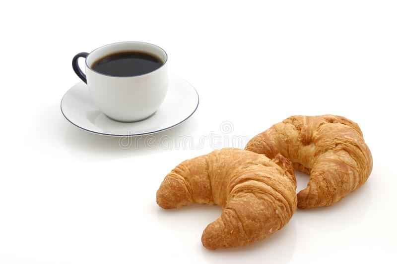 Croissant, cup of coffee royalty free stock photos