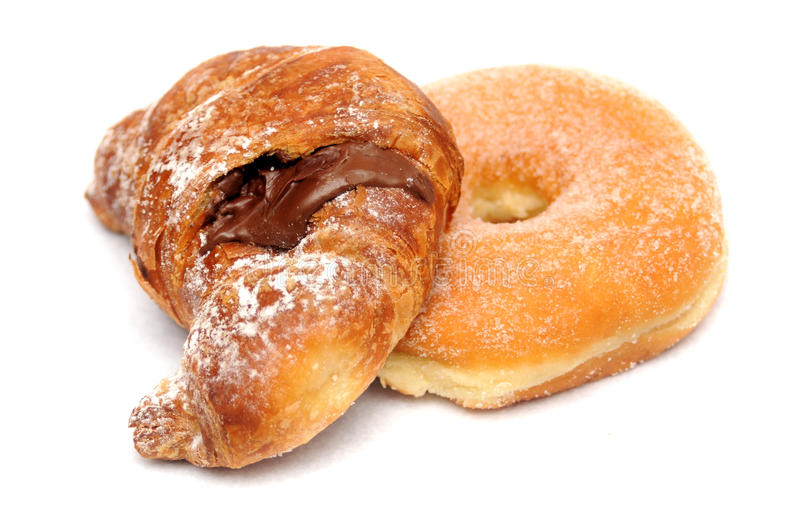 Croissant and donut. Chocolate croissant and sugar donut over white royalty free stock photo
