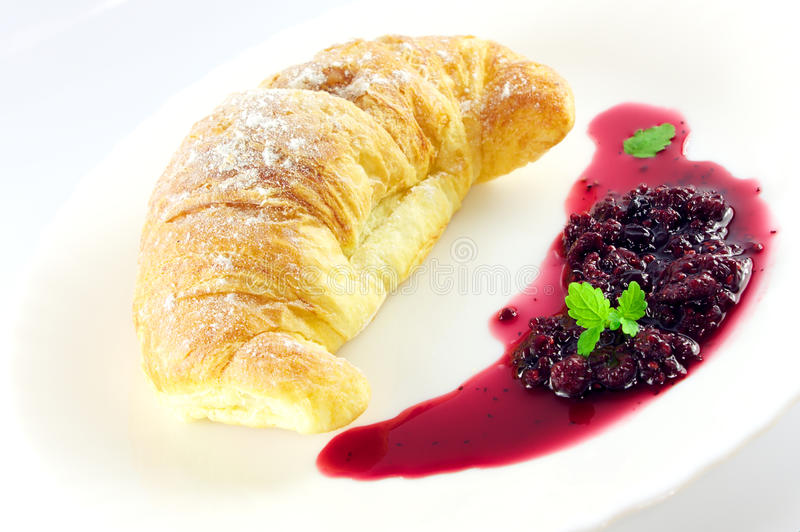 Croissant e atolamento fotografia de stock
