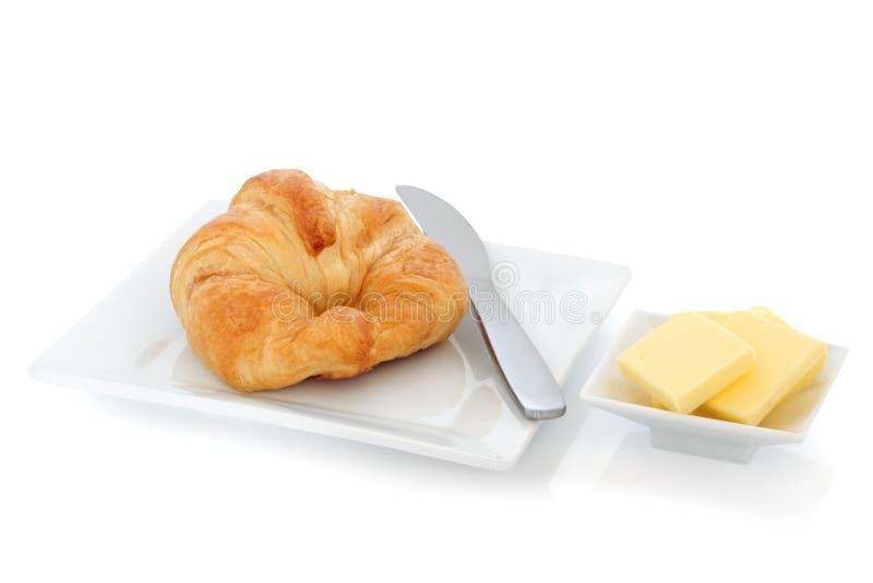 Croissant e burro fotografie stock