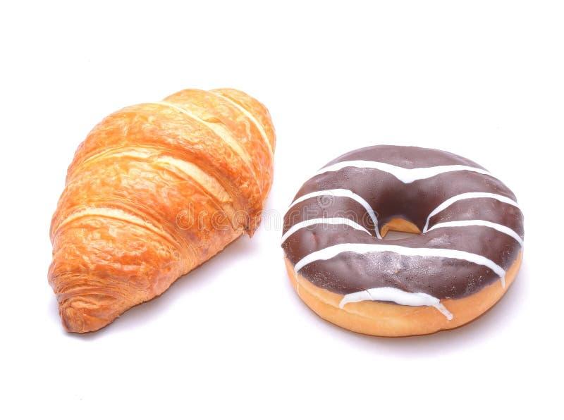 Croissant e filhós do chocolate imagens de stock royalty free