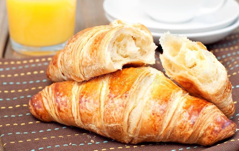 Croissant e suco de laranja fotografia de stock