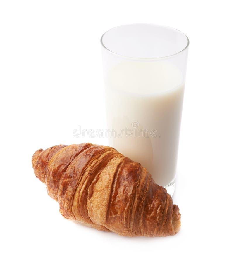Croissant e vidro do leite imagem de stock