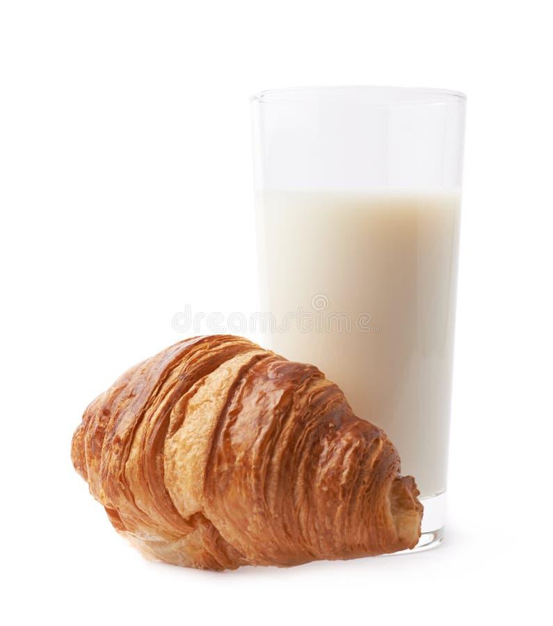 Croissant e vidro do leite fotografia de stock