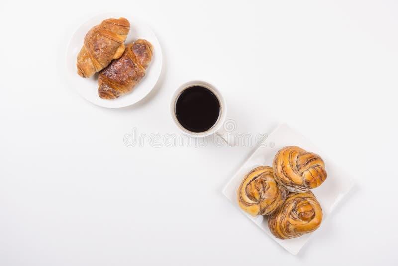 Croissant ed il Danese del caffè fotografie stock libere da diritti