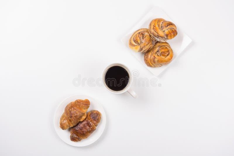 Croissant ed il Danese del caffè immagini stock