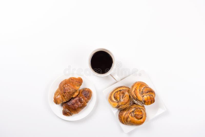 Croissant ed il Danese del caffè immagini stock libere da diritti