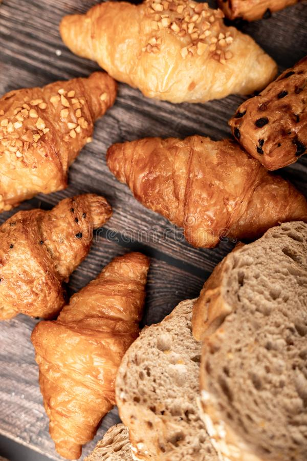 Croissant groups and bread. Croissant groups and corn bread on the wooden table, agricultural, agriculture, bake, baked, bakery, board, breakfast, cereal royalty free stock photography