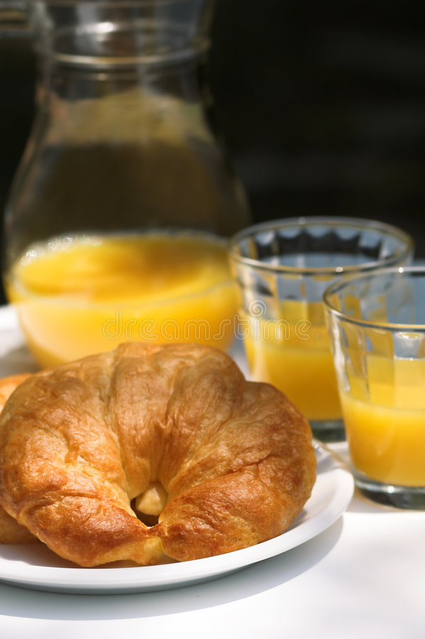 Croissant and orange juice royalty free stock photos