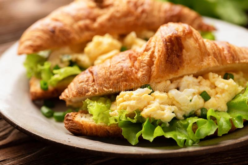 Croissant sandwich with egg cheese stock images