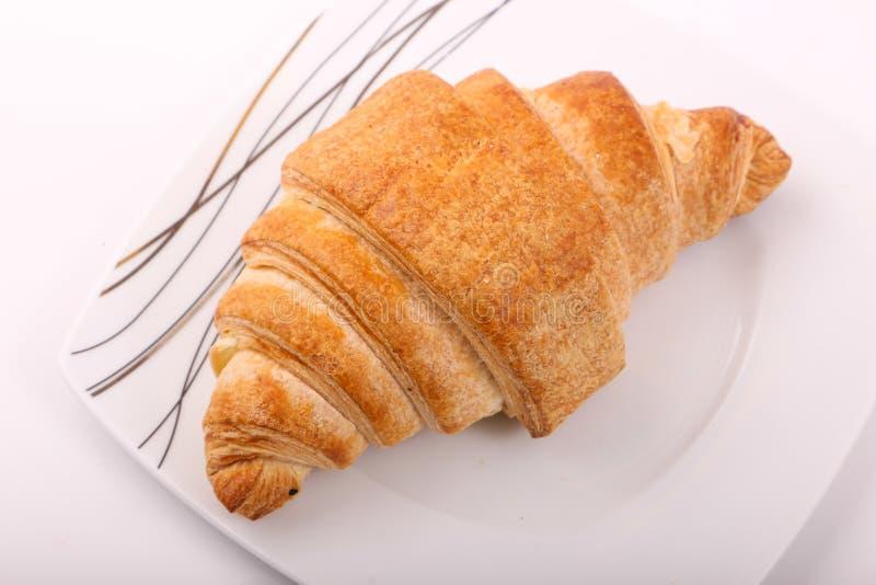 Croissant. Tasty croissant on white background stock photo
