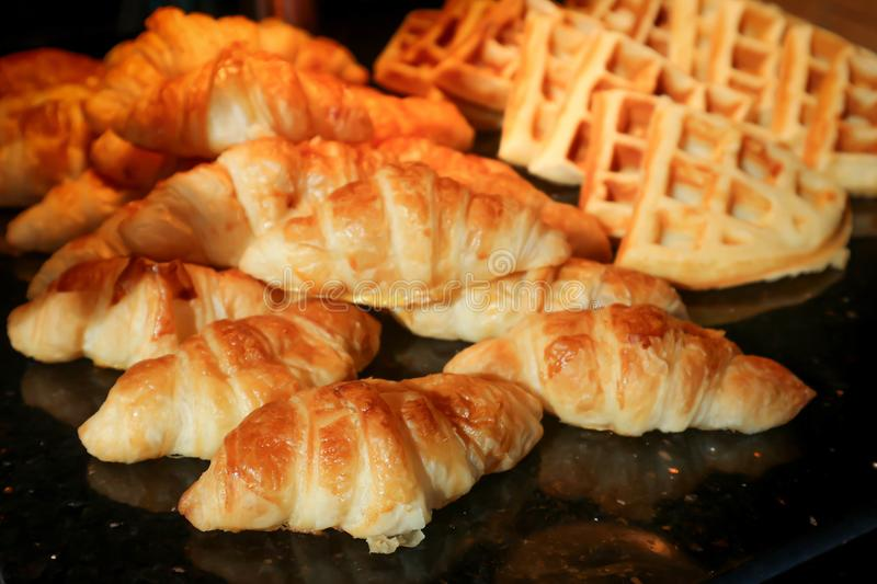 Croissant and waffle royalty free stock images