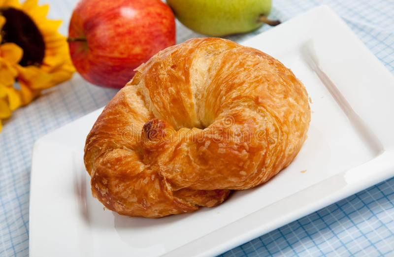 A Croissant On A White Plate With Apples Royalty Free Stock Image