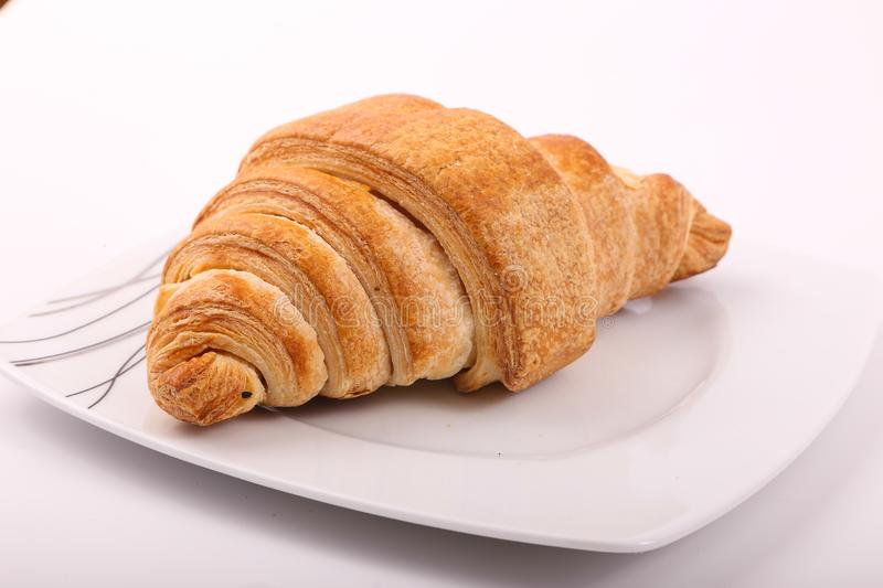Croissant. With on white plate on white background royalty free stock photography