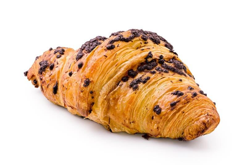 Croissant z czekoladowego układu scalonego polewą odizolowywającą na bielu obraz stock