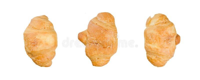 Croissants aislados en el fondo blanco imagen de archivo