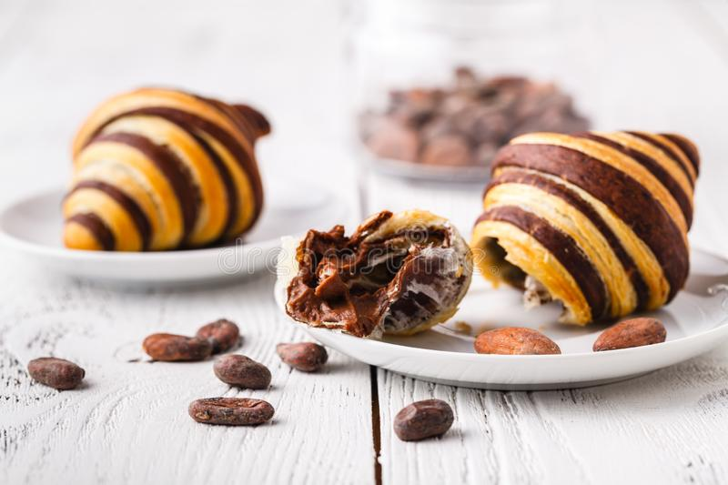 Croissants with chocolate filling cup and fresh morning coffee stock photography