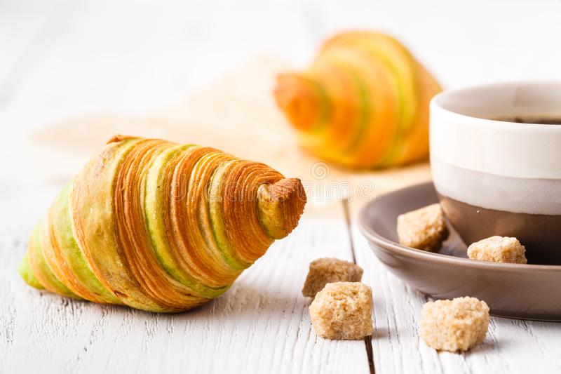 Croissants with chocolate filling cup and fresh morning coffee stock photos