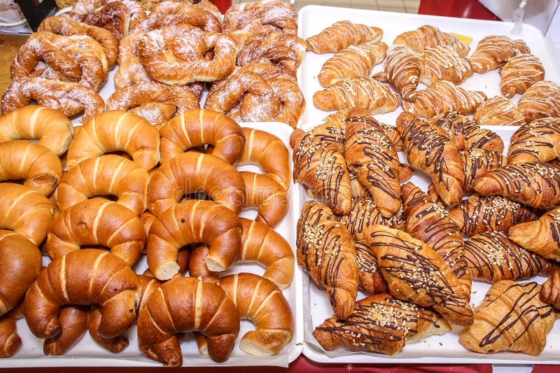 Croissants. With chocolate pastry shelf in the store stock photography