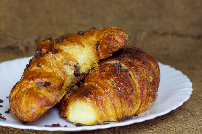 Croissants with chocolate on a plate royalty free stock photos