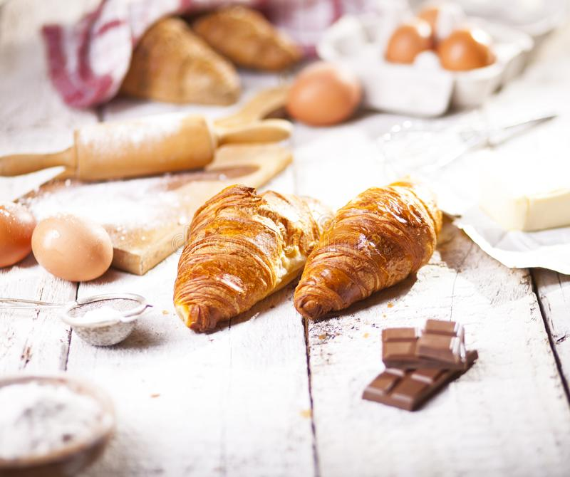 Croissants and ingredients for the preparation of bakery products. stock photos