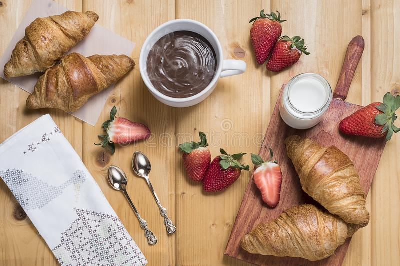 Breakfast - croissants, strawberries and hot chocolate stock images