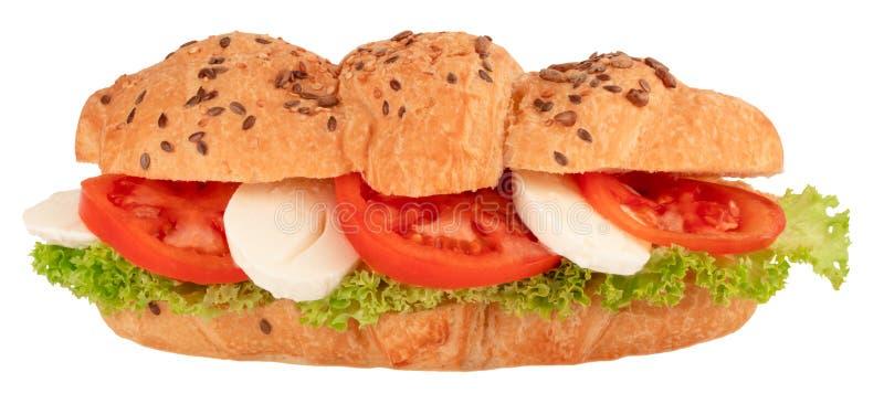 Croissantsandwich met mozarella en tomaat op witte achtergrond wordt geïsoleerd die royalty-vrije stock afbeelding