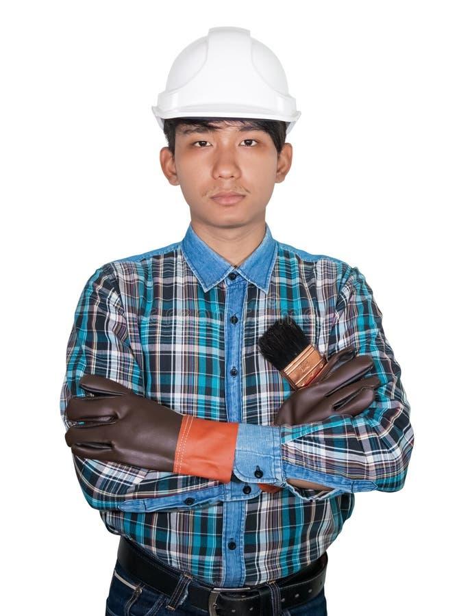Croix de main de pinceau de participation d'ing?nieur porter le bleu de chemise ray?e et le cuir de gant avec du plastique blanc  photos libres de droits