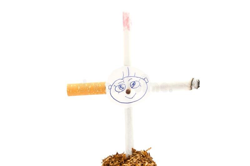 Croix des cigarettes avec le portrait sur le blanc images stock