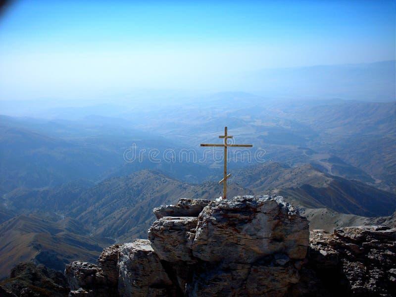 Croix sur l'alpe photographie stock