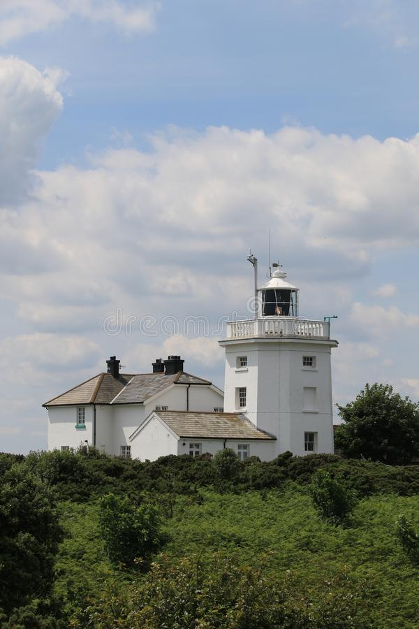 Cromer Lighthouse. There has been a lighthouse on the cliff top at Foulness, east of the town of Cromer since 1669. Before this time a light was shone from the royalty free stock image