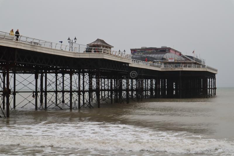 Cromer Pier from below. The grade 2 listed pier in Cromer, Norfolk from the shore below stock photography