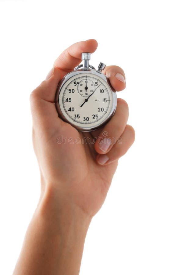 Cronómetro corriente en la mano foto de archivo