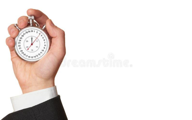 Cronômetro da terra arrendada da mão do homem. foto de stock