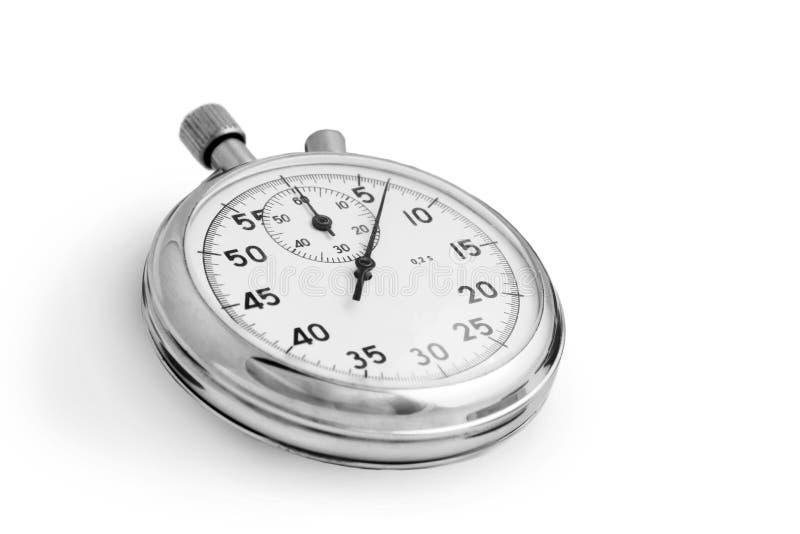 Cronometro su priorità bassa bianca fotografia stock libera da diritti