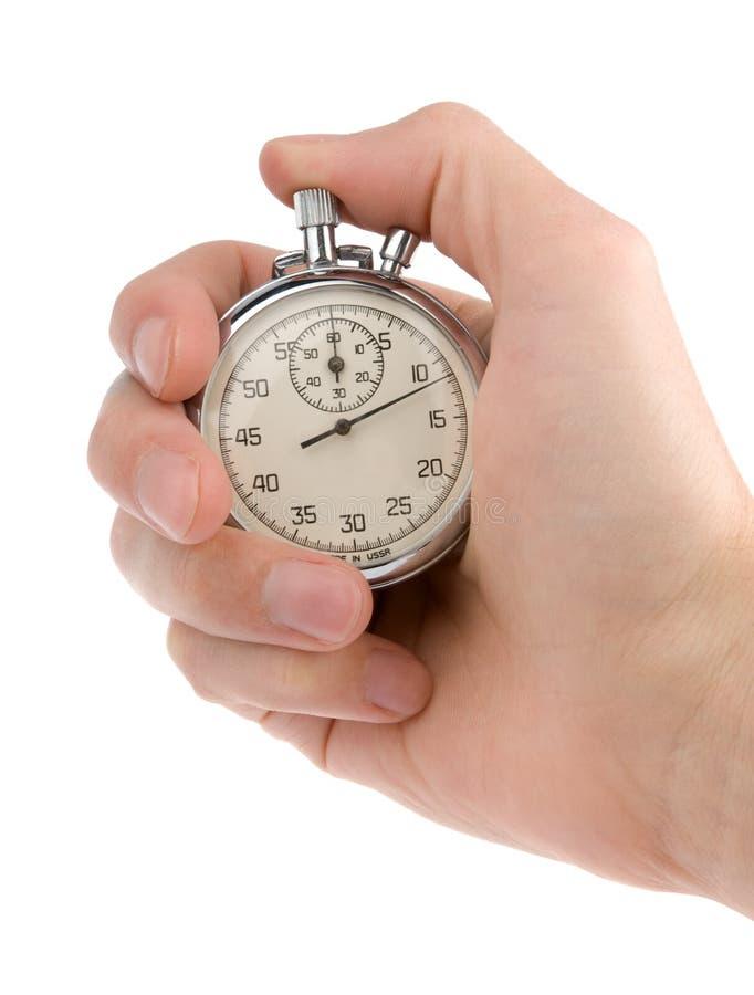 Cronometro in una mano fotografia stock