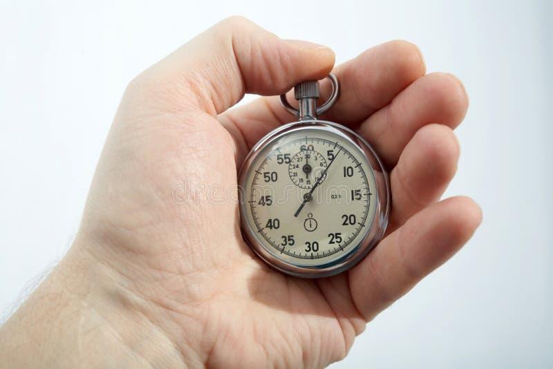Cronometro in una mano immagini stock