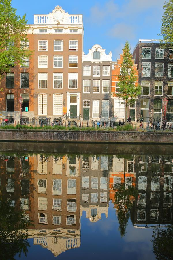 Crooked and colorful heritage buildings, overlooking Herengracht canal with perfect reflections, Amsterdam. Netherlands royalty free stock photos